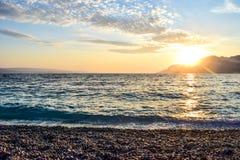 Sunset over the sea. Wonderful sunset on the Punta Rata Beach, Brela, Croatia royalty free stock photo