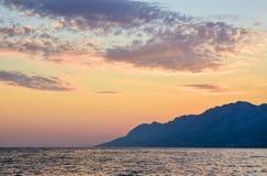 Sunset over the sea. Wonderful sunset on the Punta Rata Beach, Brela, Croatia royalty free stock photos