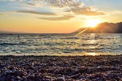 Sunset over the sea. Wonderful sunset on the Punta Rata Beach, Brela, Croatia stock photography