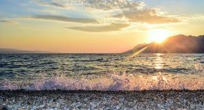 Sunset over the sea. Wonderful sunset on the Punta Rata Beach, Brela, Croatia stock images