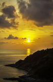 Sunset over the seascape. Beautiful sunset over the seascape with mountant Stock Photo