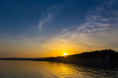Sunset over the seashore summer evening landscape sea Royalty Free Stock Images