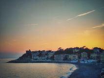 Sunset over the seaside town. An amazing sunset over the city of Genova Royalty Free Stock Photos