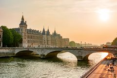 Sunset over Seine river and Conciergerie palace, Paris, France royalty free stock images