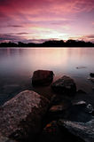 Sunset over a serene lake Royalty Free Stock Photography