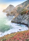 Sunset over the Sheer Cliffs of Devil`s Slide. Devil`s Slide is a coastal promontory in California, United States. It lies on the San Mateo County coast between Royalty Free Stock Photos