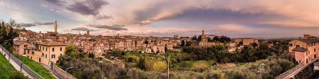 Sunset over Siena, Italy. The city of Siena (Tuscany region, Italy) is home to one of Italy's oldest universities among, oldest bank, and historical churches Stock Photo