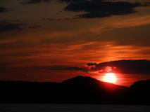 Sunset over the silhouette of mountain range Stock Photography