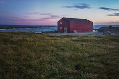 Sunset over small fishing village royalty free stock photo