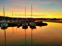Sunset over a small French marina royalty free stock photos