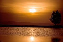 Sunset 3. Sunset over a small lake from Faget forest, near Cluj Napoca, Romania Royalty Free Stock Photography