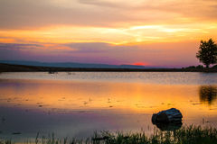 Sunset 4. Sunset over a small lake from Faget forest, near Cluj Napoca, Romania Royalty Free Stock Photo