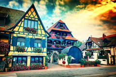 Sunset over small town with typical half-timbered houses. Alsace Royalty Free Stock Photography