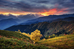 Sunset over snow-capped mountain peaks.  Royalty Free Stock Photos