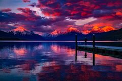 Sunset over snow capped mountains Stock Photos