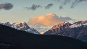 Sunset over snow capped mountains, Banff National Park stock images