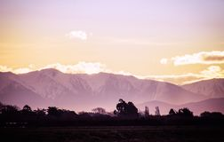 Sunset over the Snow Capped Southern Alps. Of New Zealand in winter Royalty Free Stock Images