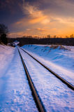 Sunset over snow-covered railroad tracks in Carroll County, Mary Royalty Free Stock Images