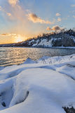 Sunset Over Snow. Winter sunset at Bluffers Park in Toronto Royalty Free Stock Image