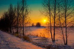 Sunset over snowy field Stock Photos