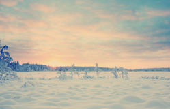 Sunset over snowy lake with Instagram style filter Royalty Free Stock Images