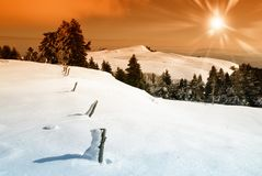 Sunset over snowy landscape Stock Photography