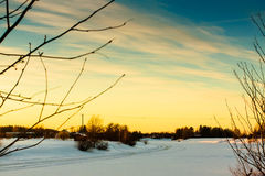 Sunset Over The Snowy River 1. The sun sets dramatically over the frozen river of Pyhajoki in the Northern Finland royalty free stock photography