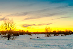 Sunset Over The Snowy River 3. The sun sets dramatically over the frozen river of Pyhajoki in the Northern Finland royalty free stock photography