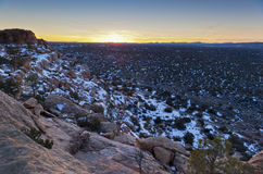 Sunset over snowy sandstone cliffs Royalty Free Stock Image
