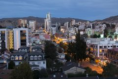 Sunset over the south area of La Paz, Bolivia. Bright lights. Over buildings streets ands homes stock photos