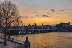 Sunset over Southbank. And the Hungerford Bridge and Golden Jubilee Bridges, London, England, United Kingdom Royalty Free Stock Images