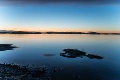 Sunset over Stockholm Archipelago. Calm evening with sunset in Stockholm Archipelago stock photo