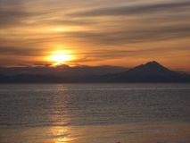 sunset over the strait royalty free stock photo