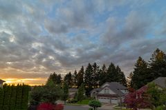 Sunset over Street of Suburban Luxury Homes Royalty Free Stock Photos