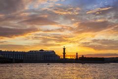 Sunset over Strelka - Spit of Vasilyevsky Island with the Old Stock Exchange and Rostral Columns, Royalty Free Stock Image