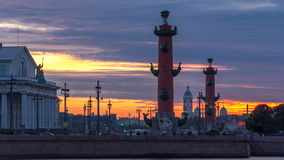 Sunset over Strelka - Spit of Vasilyevsky Island with the Old Stock Exchange and Rostral Columns timelapse in Saint stock video footage