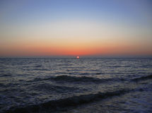 Sunset over summer sea with a small waves Royalty Free Stock Photography