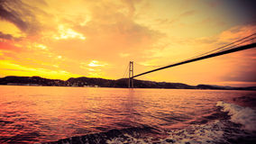 Sunset over suspension bridge in Bergen, Norway Royalty Free Stock Photos