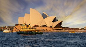 Free Sunset Over Sydney Opera House From Sydney Harbour With Ferry In Foreground Stock Photography - 127711182