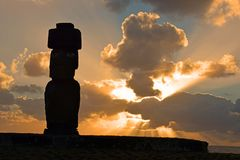 Sunset over Tahai moai with eyes, Easter Island. Sunset over the moai at Tahai, Easter Island, Chile. This is one of the only moai on the island with eyes, made Stock Photography