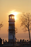 Sunset over a tall lighthouse Royalty Free Stock Images