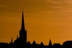 Sunset over Tallinn, Estonia. Looking out up on the silouetted skyline of Tallinn, Estonia Royalty Free Stock Photo