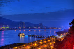 Sunset over the Tamsui River, northern Taiwan. The Tamsui River (formerly Danshui River) seen from the Guandu Temple near Taipei, Taiwan Stock Image