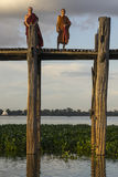 Sunset over teak bridge and monks. U bein bridge at sunset Amarapura ,Mandalay, Myanmar Royalty Free Stock Photo