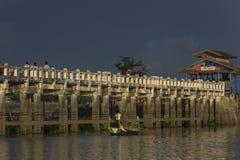 Sunset over teak bridge. U bein bridge at sunset Amarapura ,Mandalay, Myanmar Stock Photo