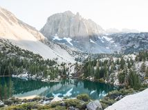 Sunset over Temple Crag, a prominent peak over Lake Two of the Big Pine Lakes. In the Sierra Nevada Stock Image