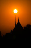 Sunset over temple, Thailand Royalty Free Stock Images