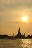 Sunset over the temple, Wat Arun on the bank of the Chao Phraya, Bangkok. Royalty Free Stock Image