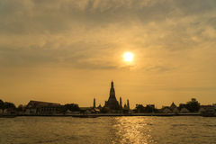 Sunset over the temple, Wat Arun on the bank of the Chao Phraya, Bangkok. Stock Photography
