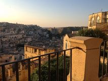 Sassi Di Matera Sunset. View over the ancient cave holiday village of Sassi Di Matera, Italy royalty free stock photography